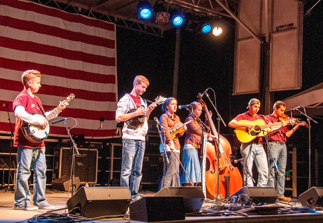 First Class Bluegrass Band onstage at Farmers Branch 2013 - with Genzels and Smith (photo by TomBarber)