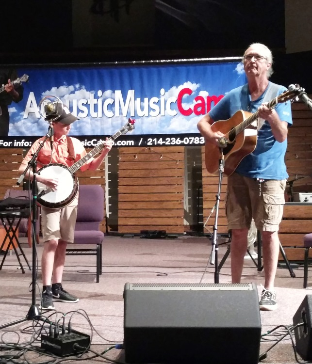Riley Gilbreath & Jim Penson on stage at Acoustic Music Camp 2017