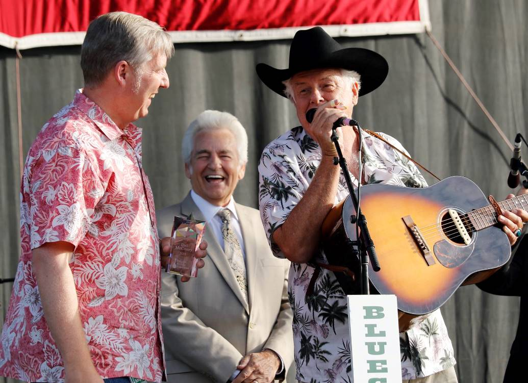 Presentation of the Bluegrass Star Award by Alan Tompkins to Del McCoury, with Peter Rowan. Photo by Nathanial Dalzell.