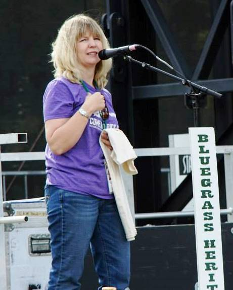Guest M/C Julie Tompkins at Bloomin' Bluegrass Festival 2015. Photo by Bob Compere