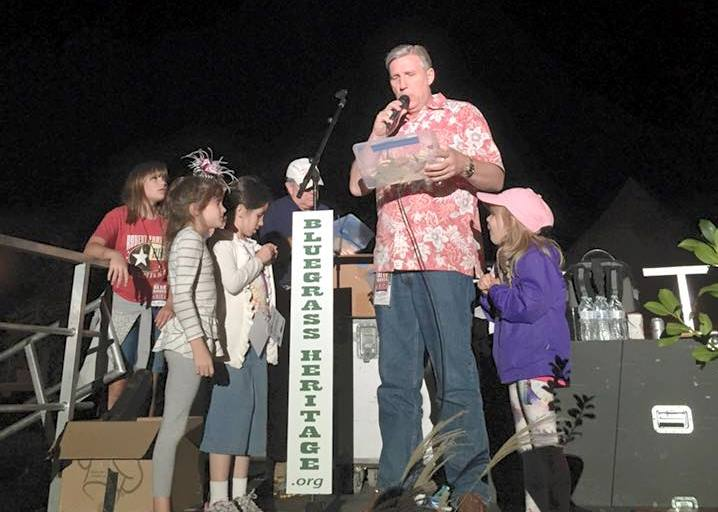 Raffle time for some excited young ladies at Bloomin' Bluegrass Festival 2015. Photo by Derrick Birdsall.